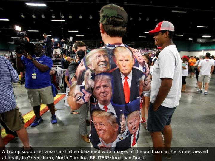 A Trump supporter wears a shirt embellished with pictures of the government official as he is met at a rally in Greensboro, North Carolina. REUTERS/Jonathan Drake