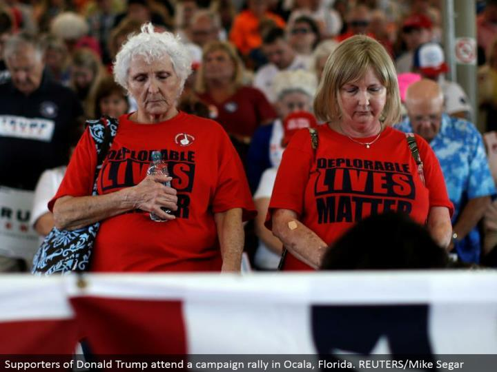 Supporters of Donald Trump go to a battle rally in Ocala, Florida. REUTERS/Mike Segar
