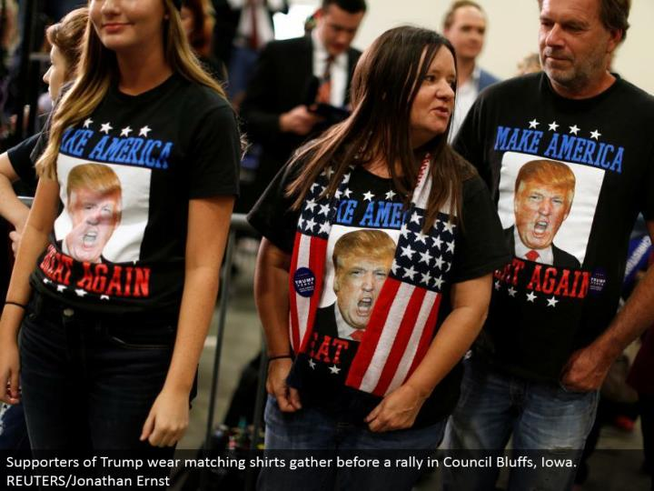 Supporters of Trump wear coordinating shirts accumulate before a rally in Council Bluffs, Iowa.  REUTERS/Jonathan Ernst