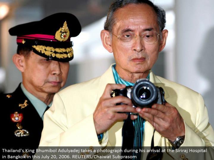 Thailand's King Bhumibol Adulyadej takes a photo amid his landing in the Siriraj Hospital in Bangkok in this July 20, 2006. REUTERS/Chaiwat Subprasom