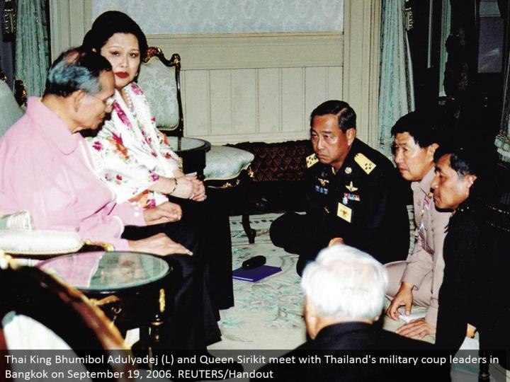 Thai King Bhumibol Adulyadej (L) and Queen Sirikit meet with Thailand's military overthrow pioneers in Bangkok on September 19, 2006. REUTERS/Handout