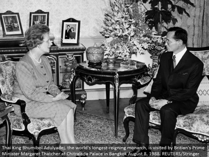 Thai King Bhumibol Adulyadej, the world's longest-prevailing ruler, is gone by Britian's Prime Minister Margaret Thatcher at Chitralada Palace in Bangkok August 8, 1988. REUTERS/Stringer