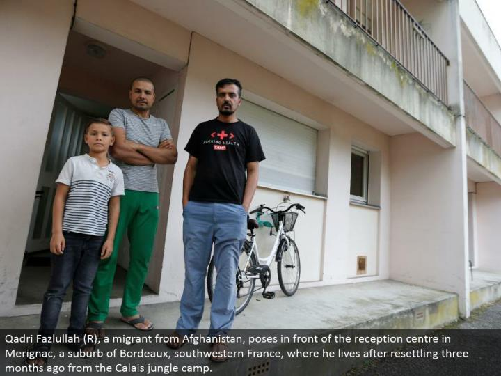 Qadri Fazlullah (R), a transient from Afghanistan, postures before the gathering focus in Merignac, a suburb of Bordeaux, southwestern France, where he lives subsequent to resettling three months back from the Calais wilderness camp.