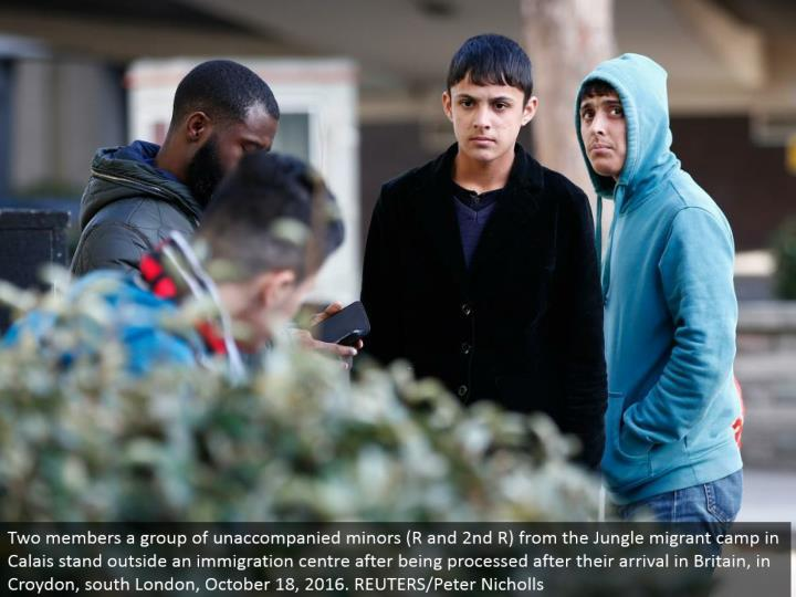 Two individuals a gathering of unaccompanied minors (R and second R) from the Jungle transient camp in Calais remain outside a movement focus in the wake of being handled after their entry in Britain, in Croydon, south London, October 18, 2016. REUTERS/Peter Nicholls