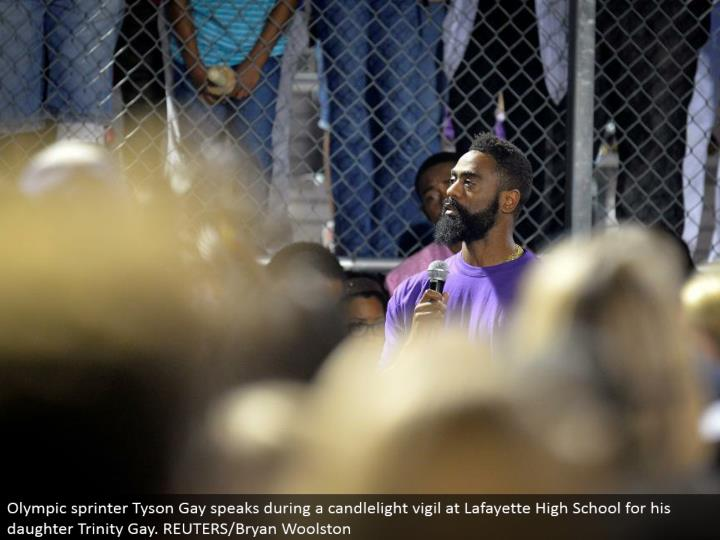 Olympic sprinter Tyson Gay talks amid a candlelight vigil at Lafayette High School for his girl Trinity Gay. REUTERS/Bryan Woolston