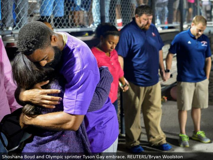 Shoshana Boyd and Olympic sprinter Tyson Gay grasp. REUTERS/Bryan Woolston