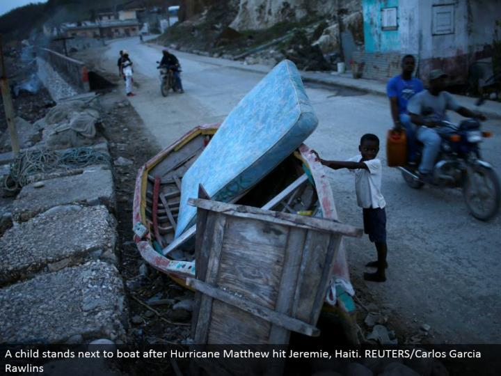 A tyke remains alongside pontoon after Hurricane Matthew hit Jeremie, Haiti. REUTERS/Carlos Garcia Rawlins