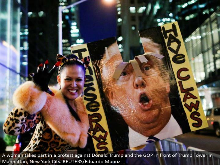 A lady partakes in a challenge Donald Trump and the GOP before Trump Tower in Manhattan, New York City. REUTERS/Eduardo Munoz