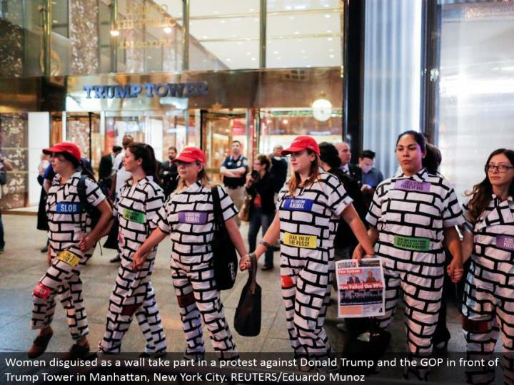 Women camouflaged as a divider partake in a challenge Donald Trump and the GOP before Trump Tower in Manhattan, New York City. REUTERS/Eduardo Munoz