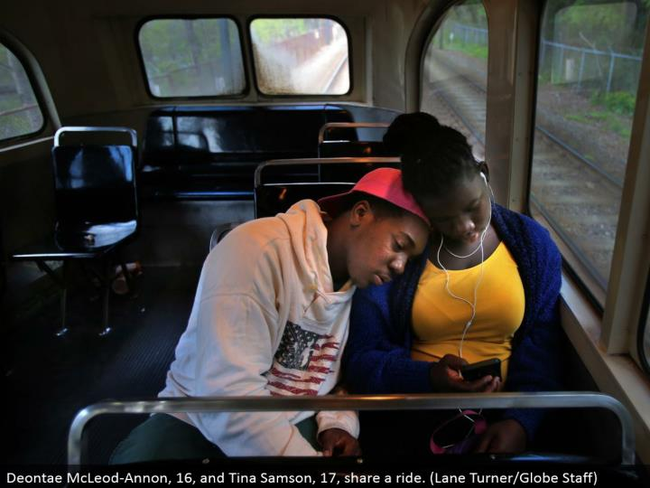 Deontae McLeod-Annon, 16, and Tina Samson, 17, share a ride. (Path Turner/Globe Staff)