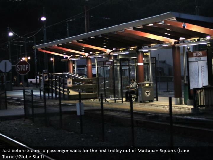 Just before 5 a.m., a traveler sits tight for the main trolley out of Mattapan Square. (Path Turner/Globe Staff)