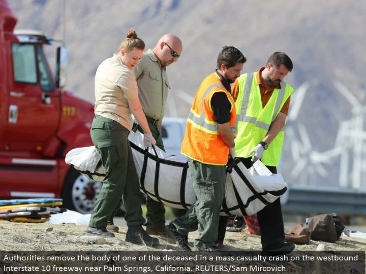 Authorities evacuate the collection of one of the expired in a mass loss crash on the westward Inter...