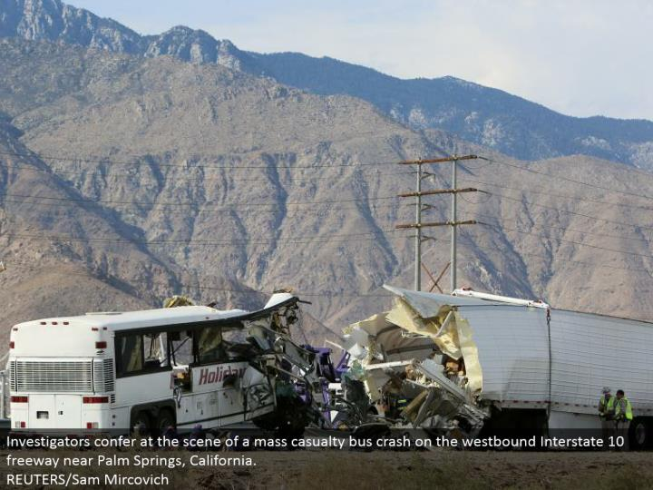 Investigators present at the scene of a mass setback transport crash on the westward Interstate 10 road close Palm Springs, California.  REUTERS/Sam Mircovich