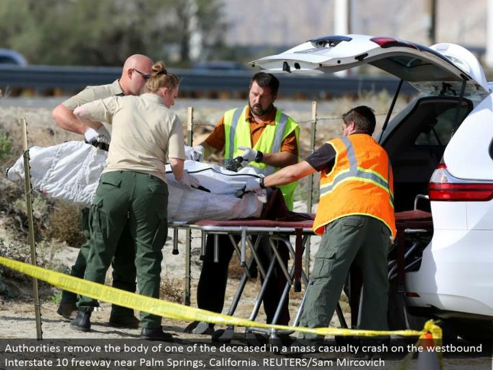 Authorities evacuate the group of one of the expired in a mass setback crash on the westward Interstate 10 road close Palm Springs, California. REUTERS/Sam Mircovich