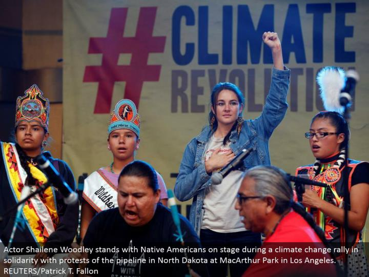 Actor Shailene Woodley remains with Native Americans in front of an audience amid an environmental change rally in solidarity with dissents of the pipeline in North Dakota at MacArthur Park in Los Angeles. REUTERS/Patrick T. Fallon