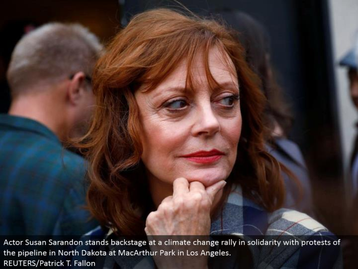 Actor Susan Sarandon stands backstage at an environmental change rally in solidarity with challenges of the pipeline in North Dakota at MacArthur Park in Los Angeles. REUTERS/Patrick T. Fallon