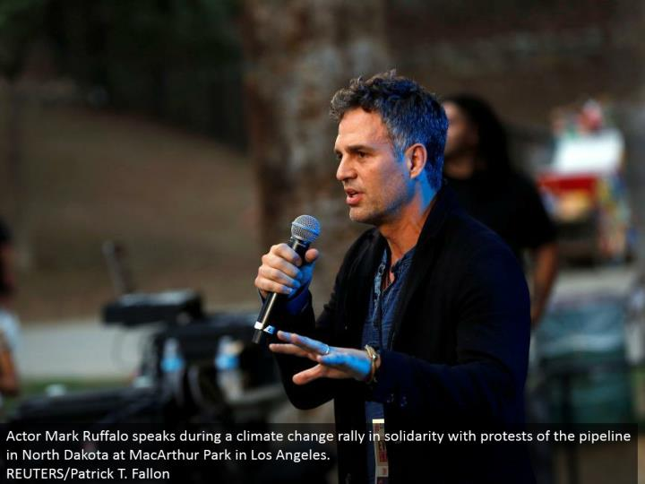 Actor Mark Ruffalo talks amid an environmental change rally in solidarity with dissents of the pipeline in North Dakota at MacArthur Park in Los Angeles. REUTERS/Patrick T. Fallon