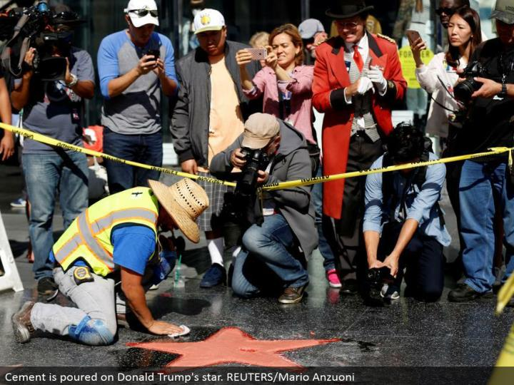 Cement is poured on Donald Trump's star. REUTERS/Mario Anzuoni