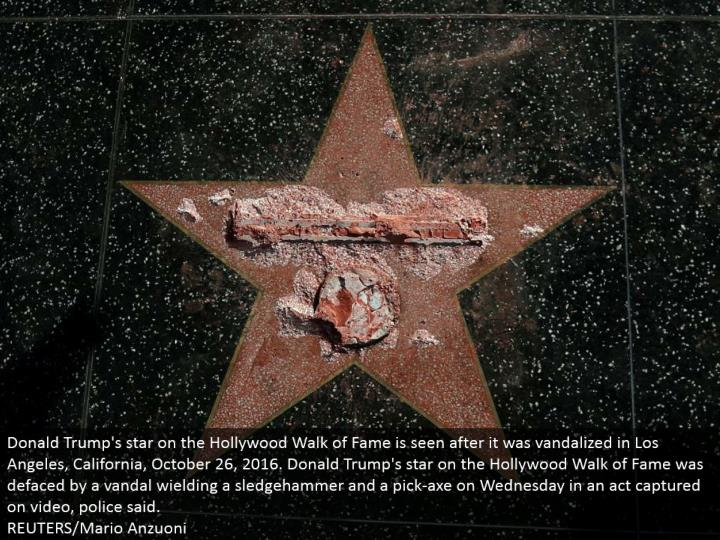 Donald Trump's star on the Hollywood Walk of Fame is seen after it was vandalized in Los Angeles, California, October 26, 2016. Donald Trump's star on the Hollywood Walk of Fame was destroyed by a vandal employing a heavy hammer and a pick-hatchet on Wednesday in a demonstration caught on video, police said. REUTERS/Mario Anzuoni