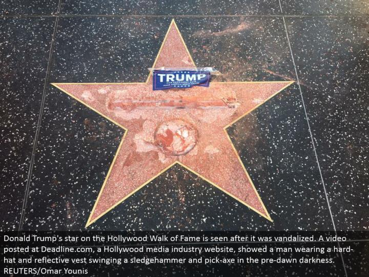 Donald Trump's star on the Hollywood Walk of Fame is seen after it was vandalized. A video posted at Deadline.com, a Hollywood media industry site, demonstrated a man wearing a hard-cap and intelligent vest swinging a heavy hammer and pick-hatchet in the pre-day break haziness. REUTERS/Omar Younis