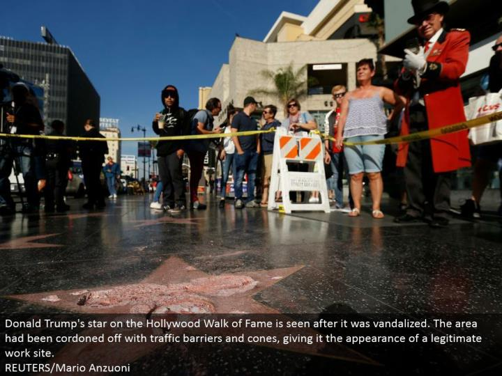 Donald Trump's star on the Hollywood Walk of Fame is seen after it was vandalized. The territory had been cordoned off with movement hindrances and cones, giving it the presence of a true blue work site.  REUTERS/Mario Anzuoni