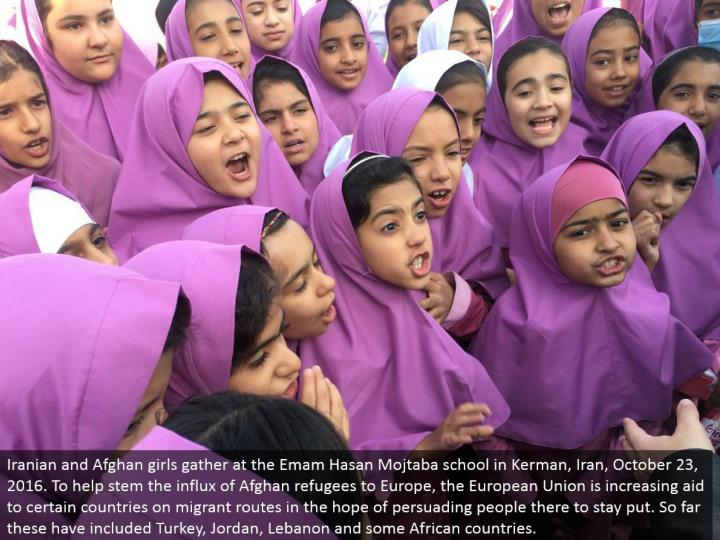 Iranian and Afghan young ladies assemble at the Emam Hasan Mojtaba school in Kerman, Iran, October 2...