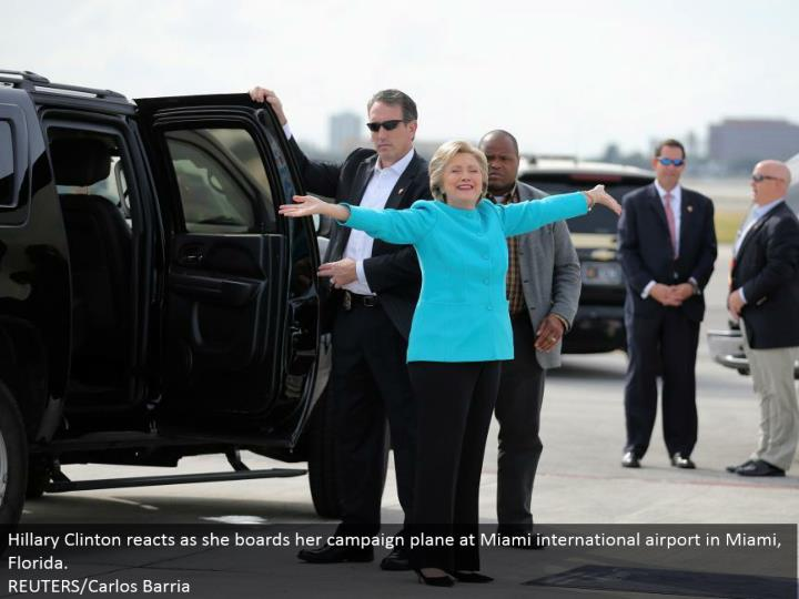 Hillary Clinton responds as she loads up her crusade plane at Miami global air terminal in Miami, Florida.  REUTERS/Carlos Barria