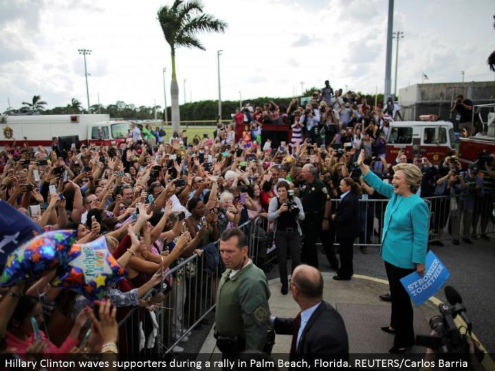 Hillary Clinton waves supporters amid a rally in Palm Beach, Florida. REUTERS/Carlos Barria