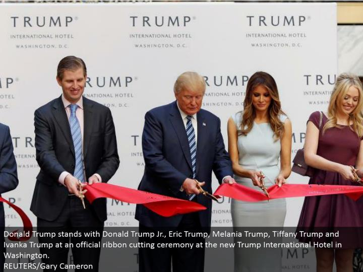 Donald Trump remains with Donald Trump Jr., Eric Trump, Melania Trump, Tiffany Trump and Ivanka Trump at an official lace cutting service at the new Trump International Hotel in Washington. REUTERS/Gary Cameron