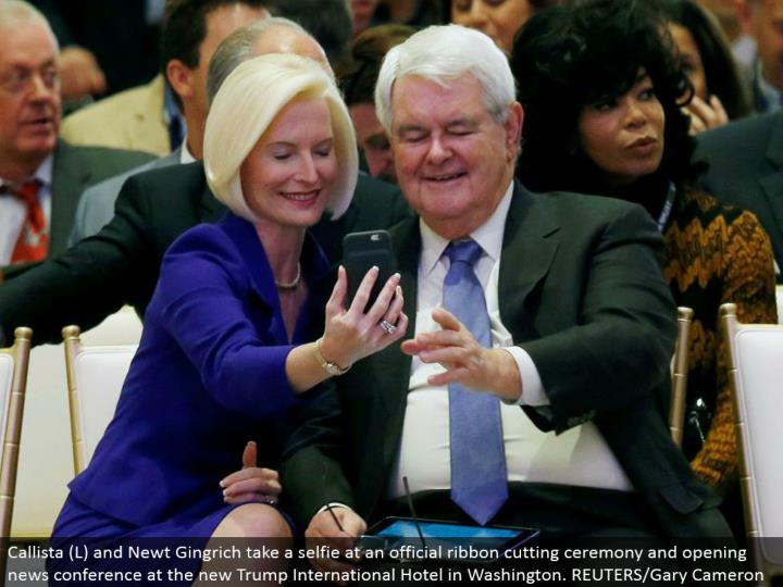 Callista (L) and Newt Gingrich take a selfie at an official lace cutting service and opening news gathering at the new Trump International Hotel in Washington. REUTERS/Gary Cameron
