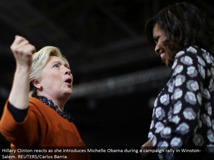 Hillary Clinton responds as she presents Michelle Obama amid a crusade rally in Winston-Salem. REUTERS/Carlos Barria
