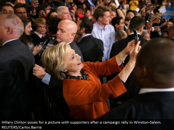 Hillary Clinton postures for a photo with supporters after a battle rally in Winston-Salem. REUTERS/...