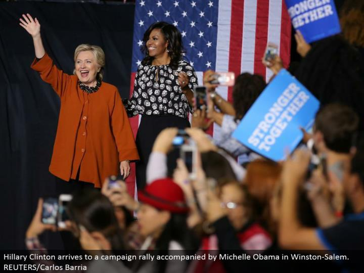 Hillary Clinton lands to a battle rally joined by Michelle Obama in Winston-Salem. REUTERS/Carlos Barria