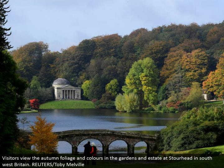 Visitors see the harvest time foliage and hues in the greenery enclosures and home at Stourhead in south west Britain. REUTERS/Toby Melville
