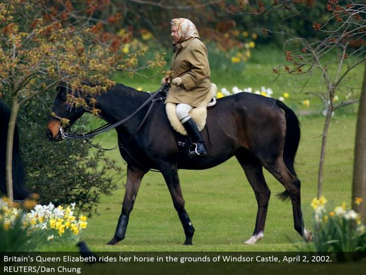 Britain's Queen Elizabeth rides her stallion in the grounds of Windsor Castle, April 2, 2002. REUTERS/Dan Chung