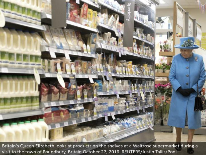 Britain's Queen Elizabeth takes a gander at items on the racks at a Waitrose store amid a visit to t...