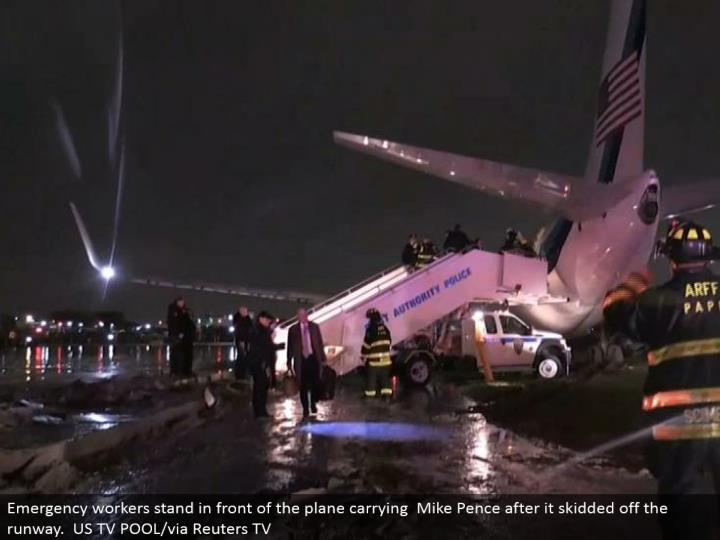 Emergency laborers remain before the plane taking Mike Pence after it slipped away the runway. US TV POOL/by means of Reuters TV