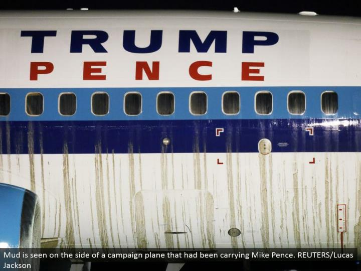 Mud is seen in favor of a crusade plane that had been conveying Mike Pence. REUTERS/Lucas Jackson