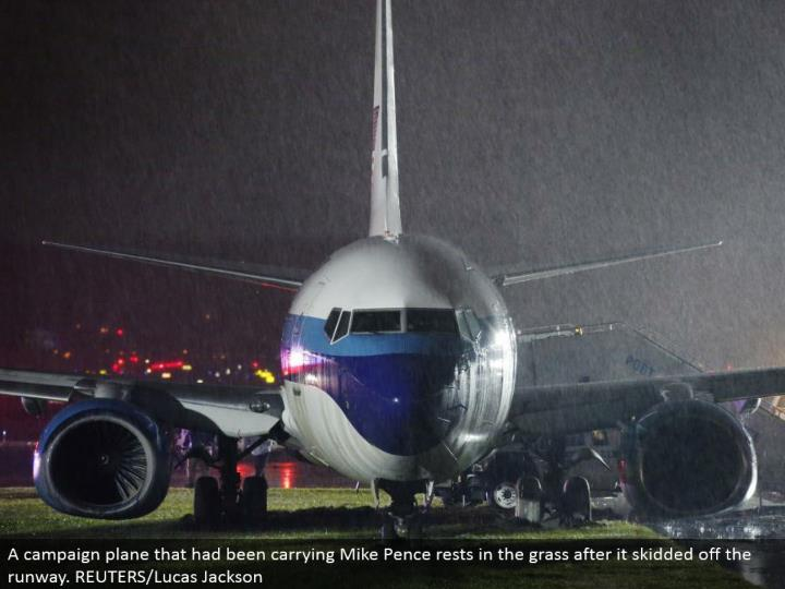 A battle plane that had been conveying Mike Pence rests in the grass after it slid off the runway. REUTERS/Lucas Jackson