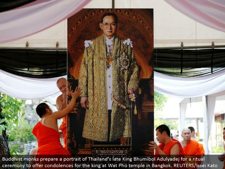 Buddhist ministers set up a representation of Thailand's late King Bhumibol Adulyadej for a custom function to offer sympathies for the lord at Wat Pho sanctuary in Bangkok. REUTERS/Issei Kato