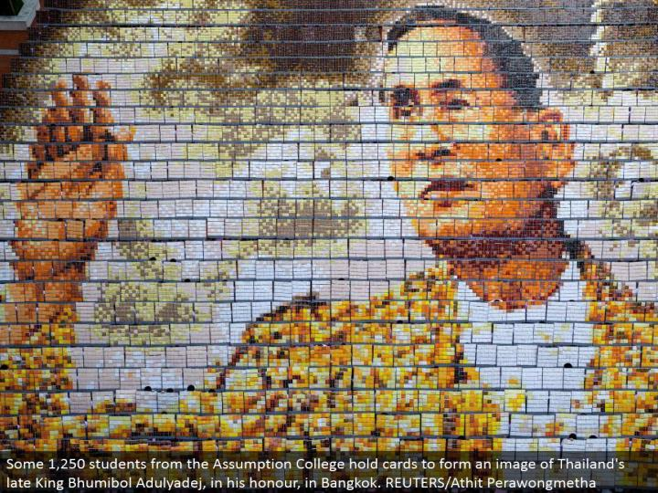 Some 1,250 understudies from the Assumption College hold cards to frame a picture of Thailand's late King Bhumibol Adulyadej, in his respect, in Bangkok. REUTERS/Athit Perawongmetha