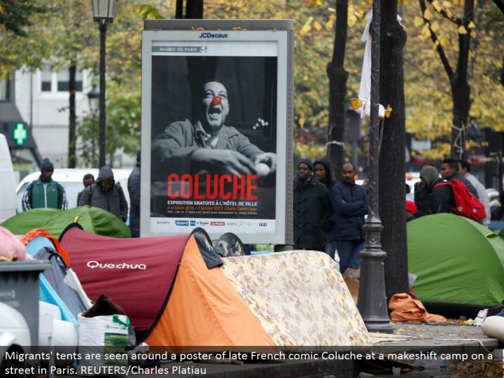 Migrants' tents are seen around a publication recently French comic Coluche at a stopgap camp on a road in Paris. REUTERS/Charles Platiau