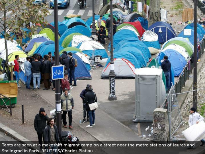 Tents are seen at a temporary transient camp on a road close to the metro stations of Jaures and Stalingrad in Paris. REUTERS/Charles Platiau
