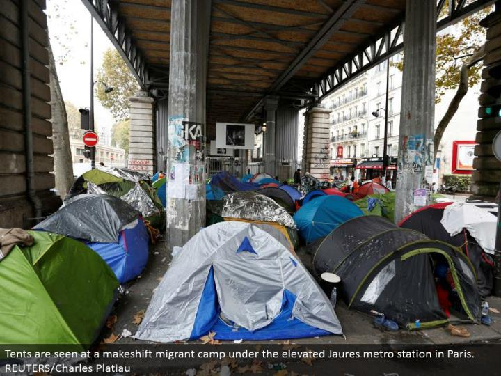 Tents are seen at an alternative vagrant camp under the lifted Jaures metro station in Paris. REUTERS/Charles Platiau