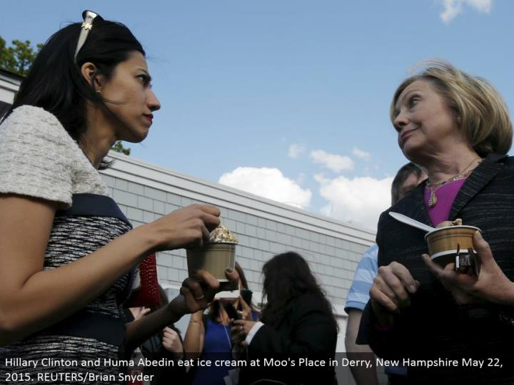 Hillary Clinton and Huma Abedin eat frozen yogurt at Moo's Place in Derry, New Hampshire May 22, 2015. REUTERS/Brian Snyder