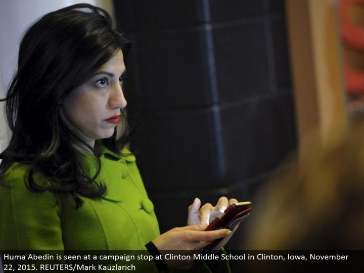Huma Abedin is seen at a battle stop at Clinton Middle School in Clinton, Iowa, November 22, 2015. REUTERS/Mark Kauzlarich