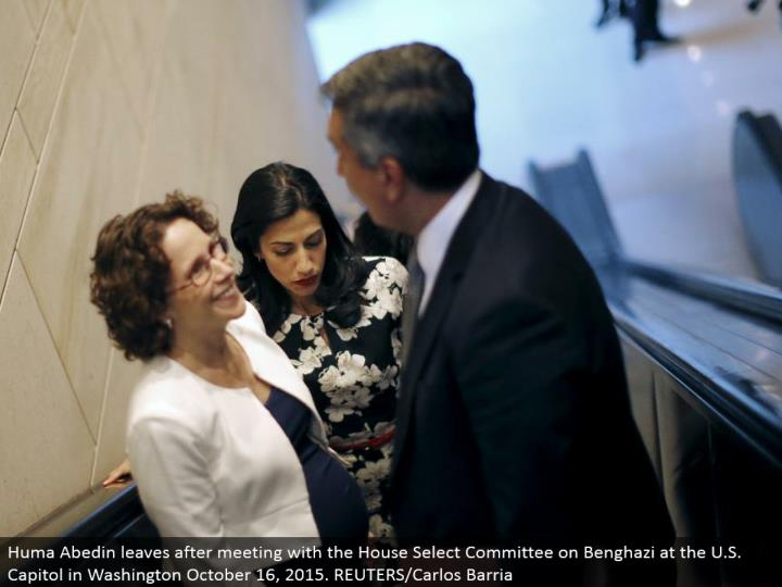 Huma Abedin goes out Select Committee on Benghazi at the U.S. Legislative hall in Washington October 16, 2015. REUTERS/Carlos Barria