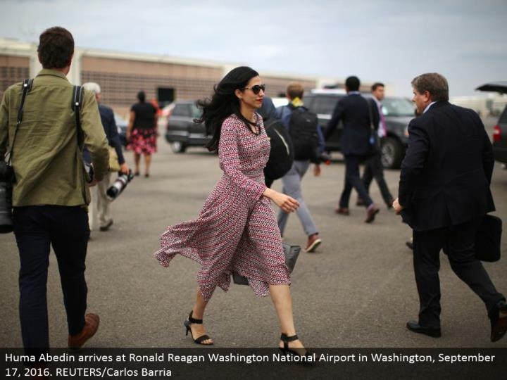 Huma Abedin touches base at Ronald Reagan Washington National Airport in Washington, September 17, 2...