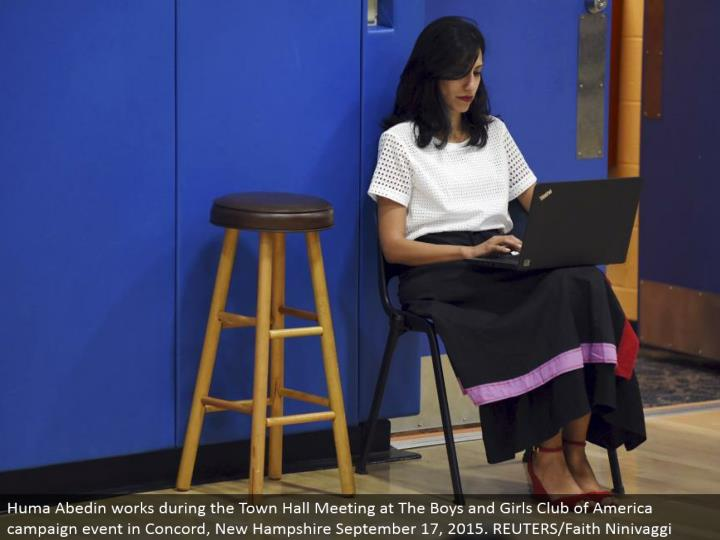 Huma Abedin works amid the Town Hall Meeting at The Boys and Girls Club of America battle occasion in Concord, New Hampshire September 17, 2015. REUTERS/Faith Ninivaggi