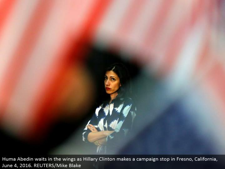 Huma Abedin holds up in the wings as Hillary Clinton makes a crusade stop in Fresno, California, Jun...